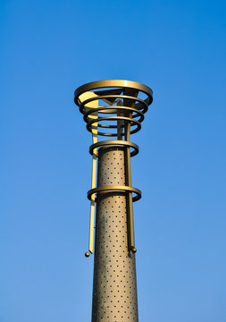 steel torch against blue sky