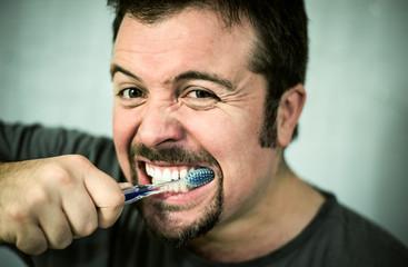Man washing his teeth