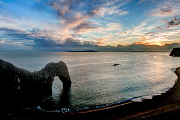 Fototapete - Durdle Dor a rock arch Dorset England