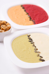 Different colored puree soups