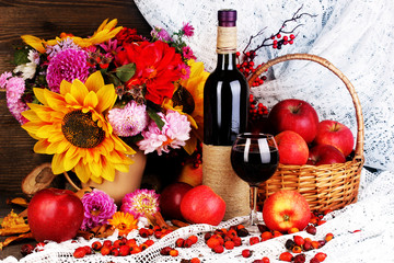 Colorful autumn still life with apples and and wine close-up