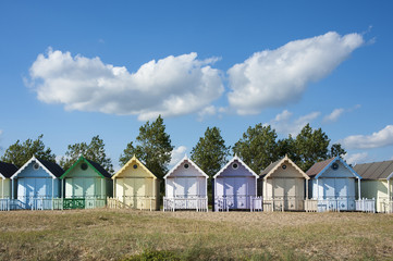 Colorful Beach Huts at West Mersea, Essex, UK.