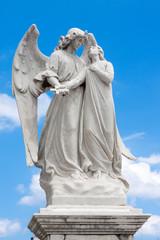 Statue of an angel guarding a beautiful young girl