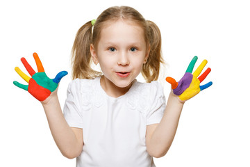 Little girl with with the palms painted by a paint