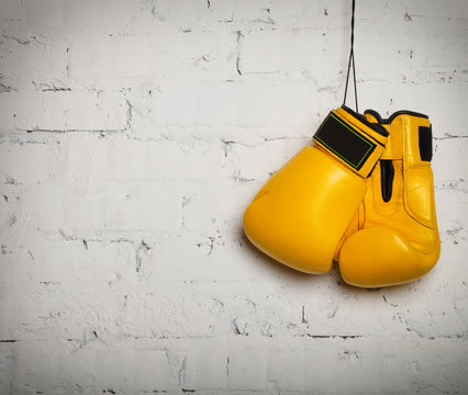 Pair of boxing gloves hanging on a wall