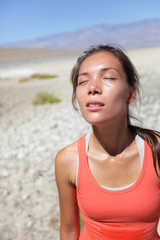 Thirst - dehydrated thirsty woman sweating desert