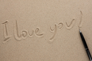 I love you written in pen on the sand