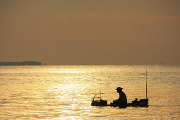 Silhouette of fisherman at sunrise, Gulf of Thailand, Cambodia
