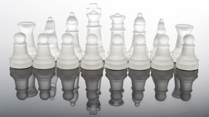transparent glass chess pieces with reflection