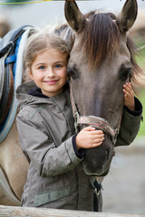 Photo sur Plexiglas Equitation Horse and lovely equestrian girl