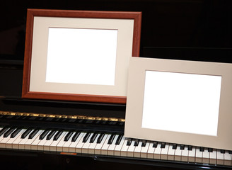Two empty frames on piano