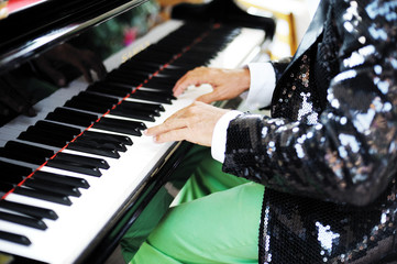 hands of a man playing piano
