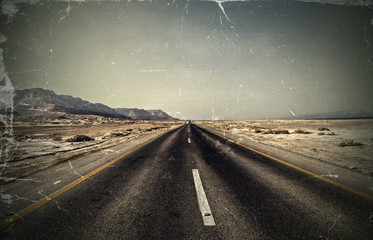 Vintage photo. Road in the desert.