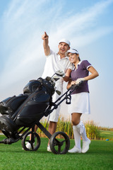 Young couple with golf bag