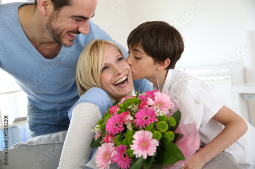 Young boy with father celebrating mother's day