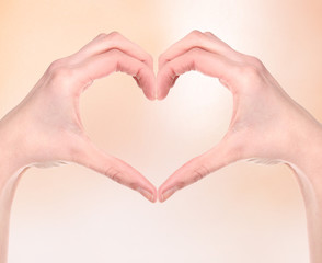 Woman hand making sign Heart
