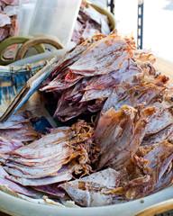 Sea food at market. Selling dry calamari in Thailand