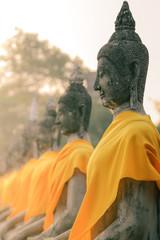 A row of Buddha statues peacefully seated at Wat Yai Chaimongkol