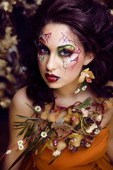 floral face art with orchids jewelry