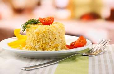 Delicious risotto with vegetables on table in cafe