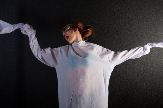 Young insane woman with straitjacket with pilot glasses