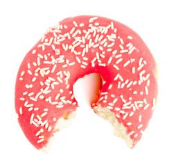 Half eaten red Donut with sugar sprinkles