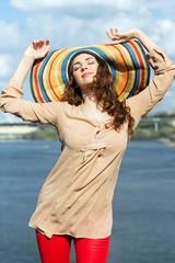 Brunette wearing colorful hat