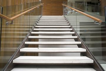 Foto op Plexiglas Trappen Modern white stairs with wooden handrail