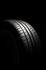 Tire on black background