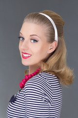young attractive blondie pinup girl in striped dress