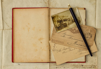 Background with vintage photograph and empty open book