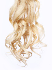 curly blonde hair over white background