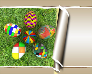 flower of easter eggs on the grass, with torn paper
