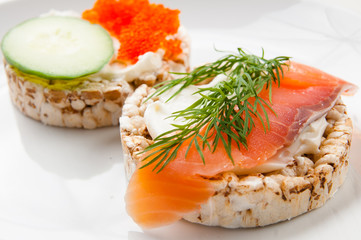 Appetizers with red fish and red caviar