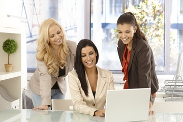 Happy businesswomen working together at office
