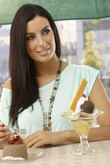 Attractive woman having cake smiling