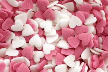 Pink and white sugar hearts background