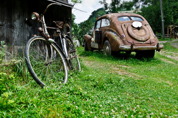 Old vintage car and bicycle in the village
