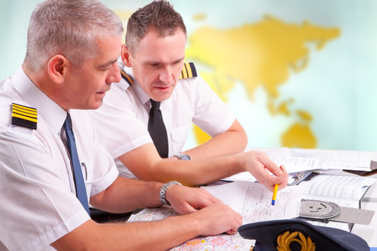 Airline pilots filling in papers in ARO