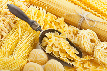retro still life with assortment of uncooked pasta