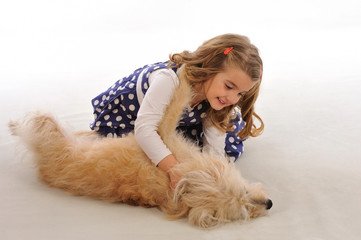 Litle girl and her dog on white background