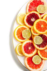 Tuinposter Plakjes fruit Grapefruit, orange, lime and lemon slices