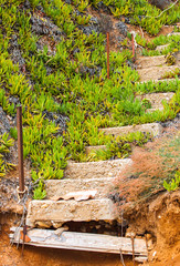 Old ruined concrete stairs at the beach, Halkidiki, Greece