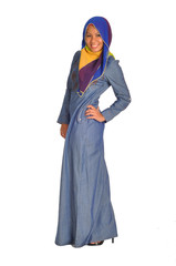 Young Muslim woman in modern clothes, isolated on white