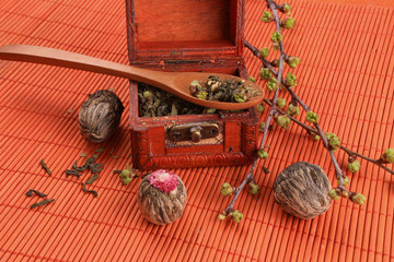 -----  tea chest with dry lotus flowers on an orange background