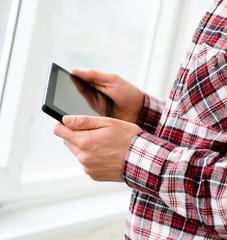 engineer uses a digital tablet