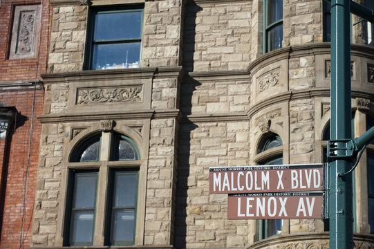 Malcom X and Lenox Avenue sign in Harlem, new York