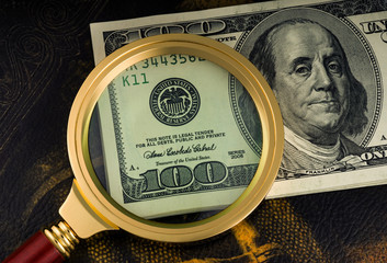 Usa dollars viewed through a magnifying glass