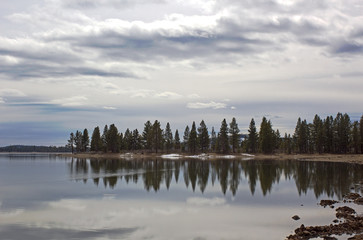 Beautiful cloudy sky reflections on a mountain reservoir lake