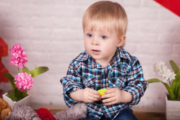 funny lovely baby boy little child in trendy jeans.
